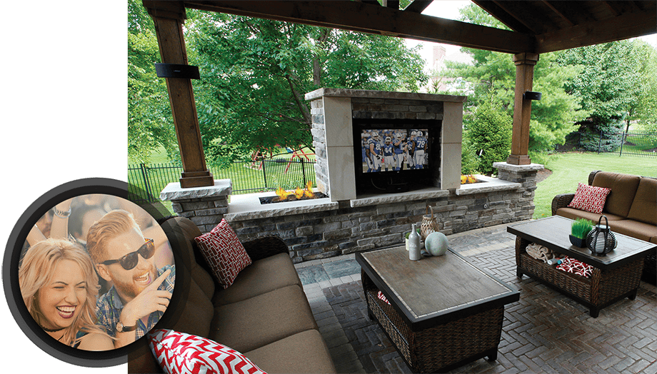 custom outdoor entertainment space with young man and women smiling