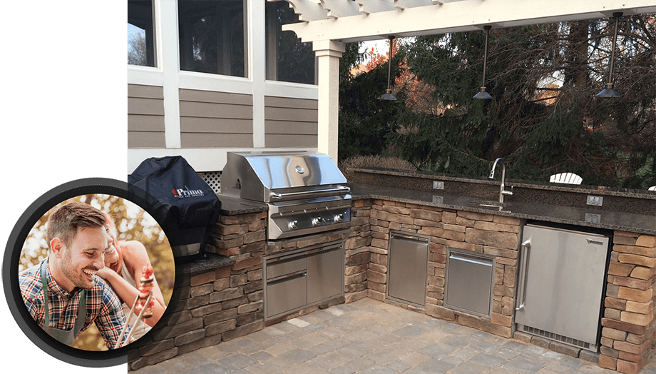 full outdoor kitchen with man grilling skewers